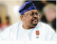 The Stamp Of His Honour… Mike Adenuga Jr. Receives France's Highest National Honour